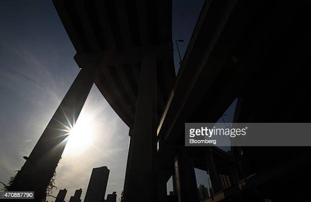 Elevated expressways are silhouetted as they stand in Shanghai China on Thursday April 23 2015 China's gross domestic product expanded 7 percent in...