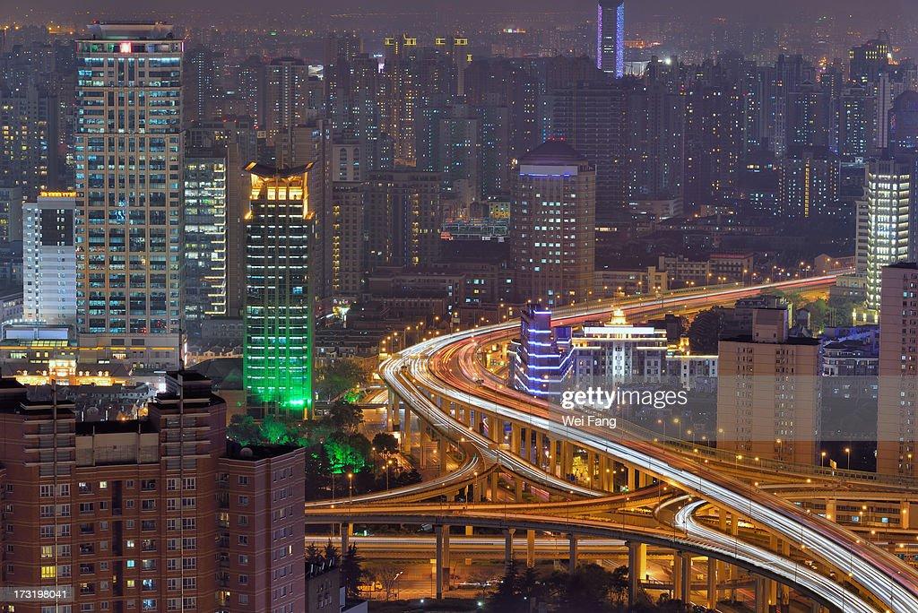 Elevated motorways winding through the city : Stock Photo
