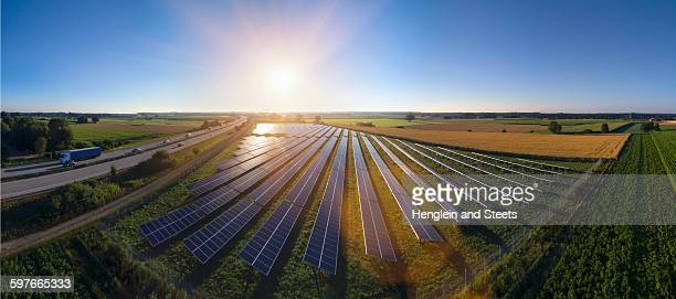Elevated panoramic landscape with rows of solar panels, Bavaria, Germany