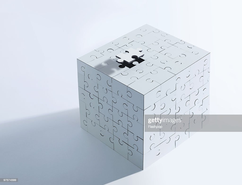 Elevated puzzle piece lifted from puzzle box : Stock Photo