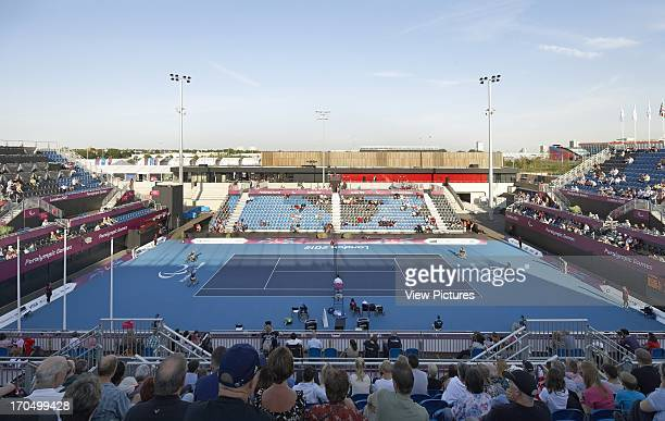 Elevated view from stand to tennis court during competition Eton Manor Olympic Park London United Kingdom Architect Stanton Williams 2012
