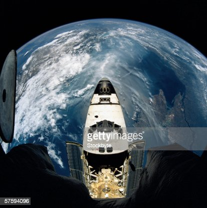 Elevated view of a spacecraft orbiting over the earth