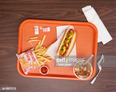 Elevated View of a Tray With Fries, a Hot Dog and Cola