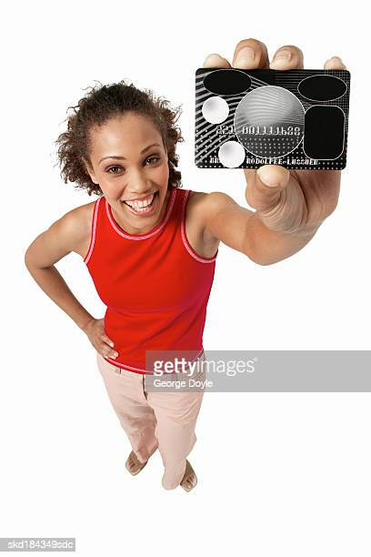 elevated view of a woman holding a credit card