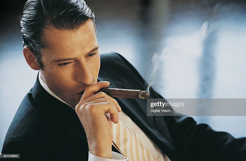 Elevated View of a Young CEO Smoking a Cigar : Stock Photo