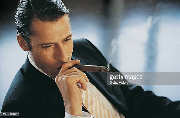 Elevated View of a Young CEO Smoking a Cigar