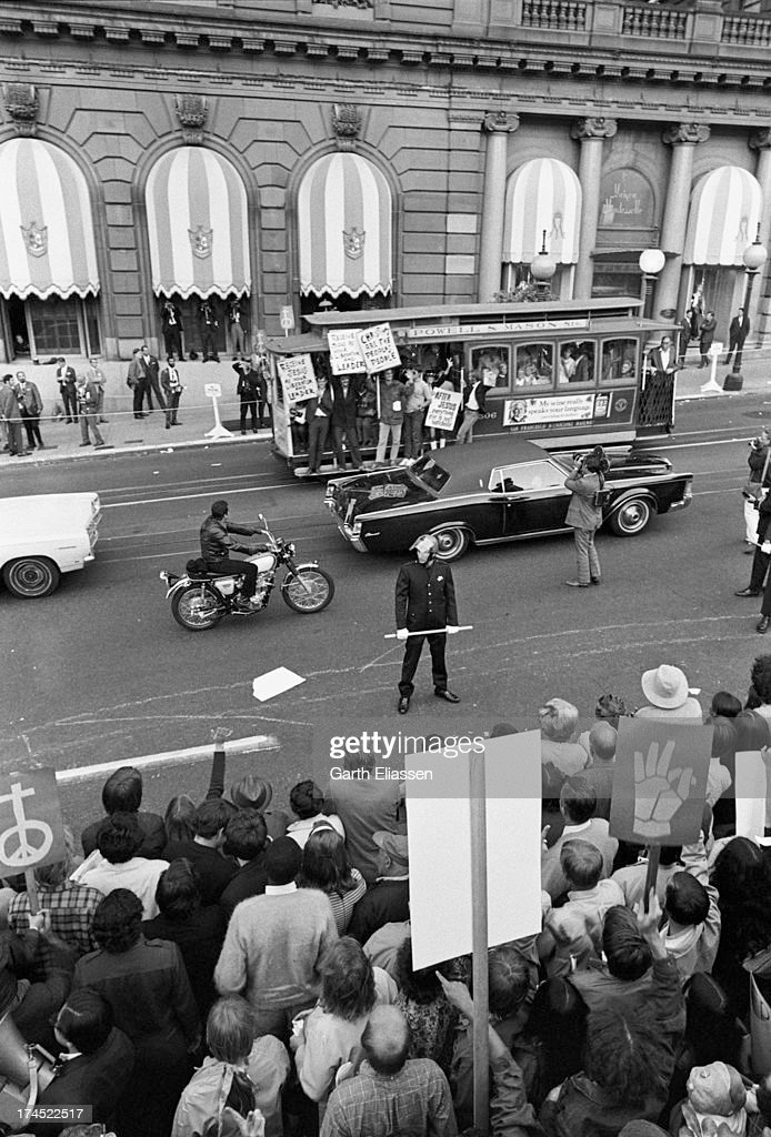 Elevated view of antiVietnam War protesters in Union Square and on a passing street car as they await President Nixon's arrival at the St Francis...