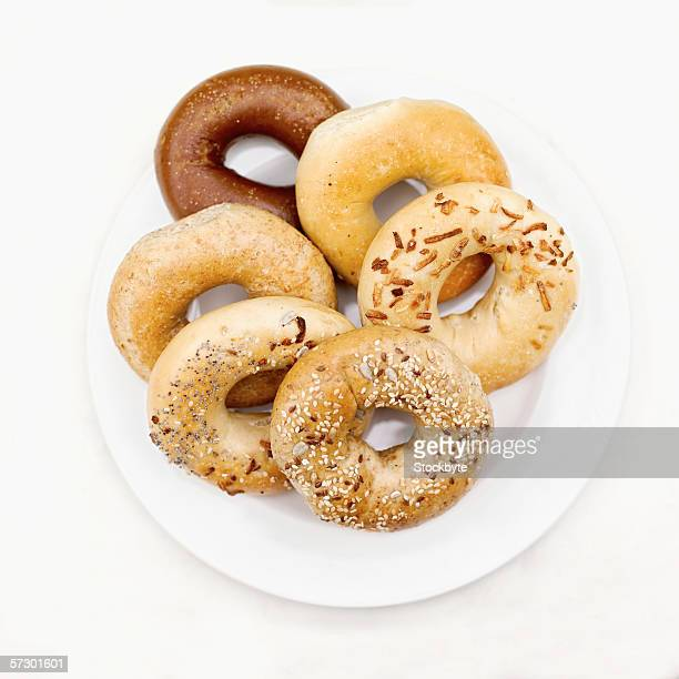 Elevated view of assorted bagels on a plate