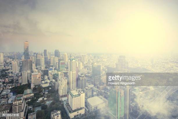 Elevated view of Bangkok with clouds and mist