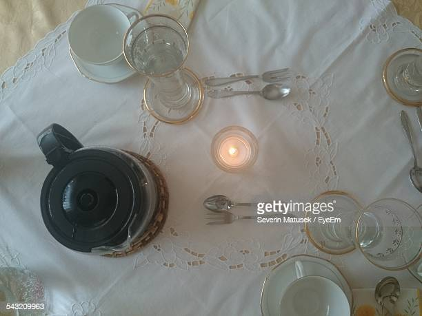 Elevated View Of Cups In Table