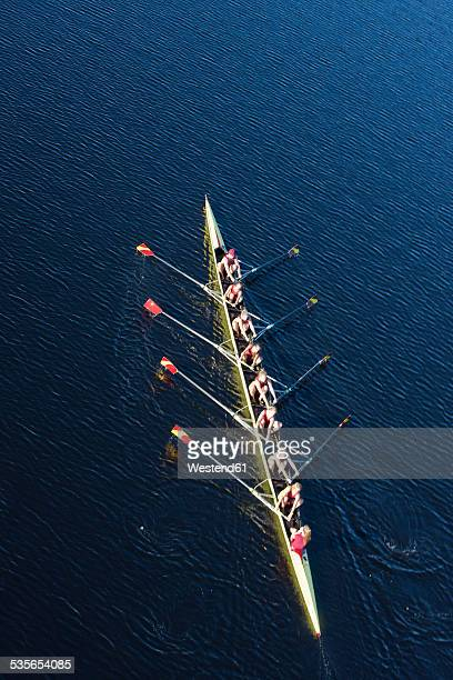 Elevated view of females rowing eight in water