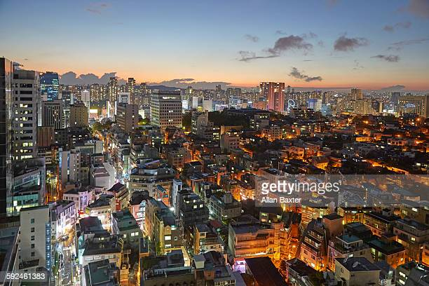 Elevated view of Gangnam illuminated at dusk