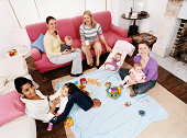 Elevated View of Mothers Playing with Babies in a Living Room