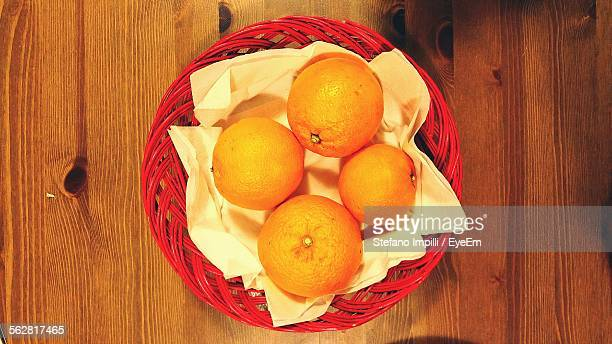 Elevated View Of Oranges In Red Basket