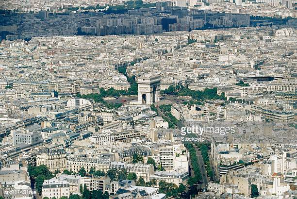 elevated view of Paris, focusing on the Arc de Triomphe