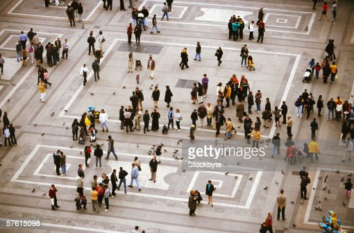 Elevated view of people walking in a square : Foto de stock