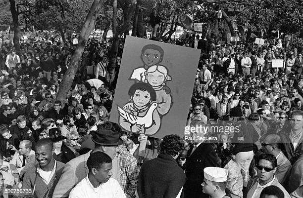 Protesters gather at an Oakland city park at the end of the Vietnam Day Protest march at the University of California Berkeley California 1965
