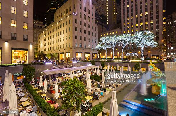 Elevated view of restaurant and Rockefeller Centre at night, New York, USA