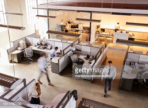 Elevated view of staff working in a busy open plan office : Stock Photo
