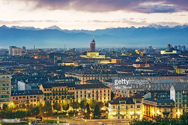 Elevated view of Turin and the Alps at dusk