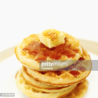 Elevated view of waffles served with syrup and butter