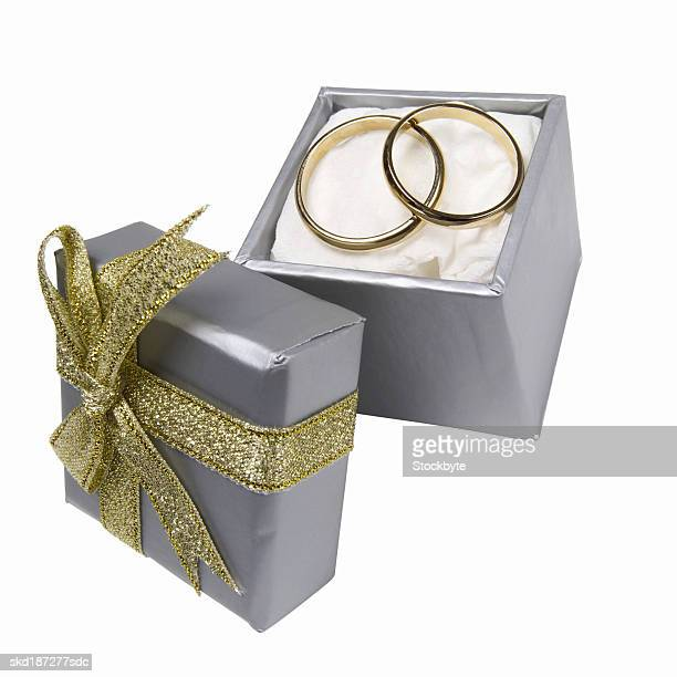 Elevated view of wedding rings in a box