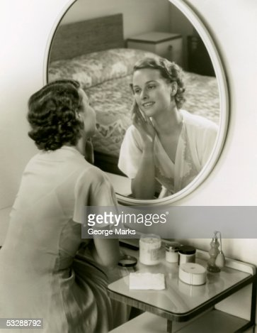 Elevated view of woman sitting at vanity : Stock Photo
