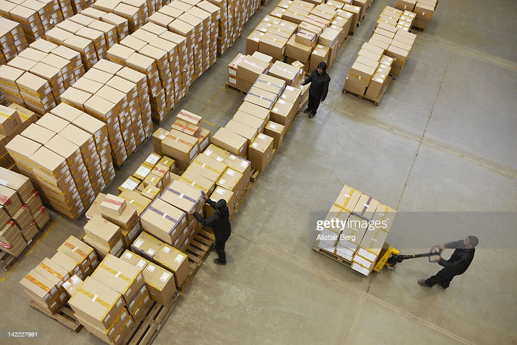 Elevated view of workers in a warehouse : Stock Photo
