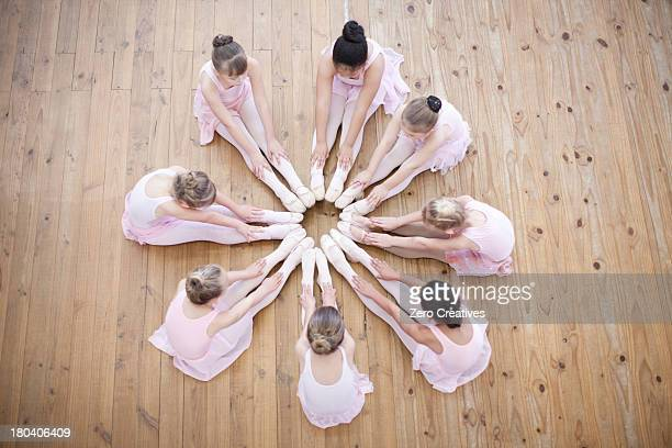 Elevated view of young ballerina group in circle