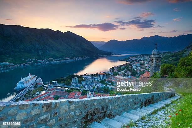 Elevated view over Kotors Stari Grad (Old Town) and The Bay of Kotor at sunset, Kotor, UNESCO World Heritage Site, Montenegro, Europe