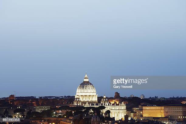 Elevated view over rooftops in Rome at dusk