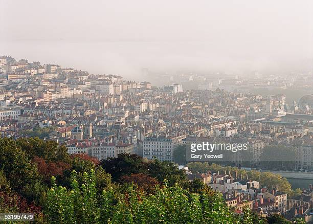 Elevated view over the city of Lyon in mist
