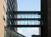 Silhouette of People walking on a bridge between two buildings, Mount Sinai Medical Center, New York City, NY, USA.