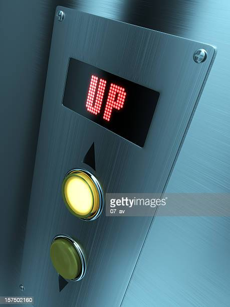 LED elevator control panel with up written on it