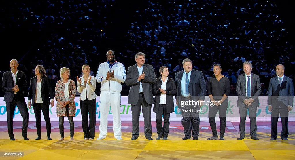 Eleven French Judo Olympic gold medallists (L-R): Djamel Bouras, Severine Vandenhende, Cecile Nowak, Marie-Claire Restoux, <a gi-track='captionPersonalityLinkClicked' href=/galleries/search?phrase=Teddy+Riner&family=editorial&specificpeople=4114927 ng-click='$event.stopPropagation()'>Teddy Riner</a>, <a gi-track='captionPersonalityLinkClicked' href=/galleries/search?phrase=David+Douillet&family=editorial&specificpeople=220892 ng-click='$event.stopPropagation()'>David Douillet</a>, Cathrine Fleury, Angelo Parisi, Lucie Decosse, Thierry Rey and Marc Alexandre are applauded by the audience during the 2015 Paris Grand Slam on October 18, 2015 at the Bercy-Paris Arena in Paris, France.