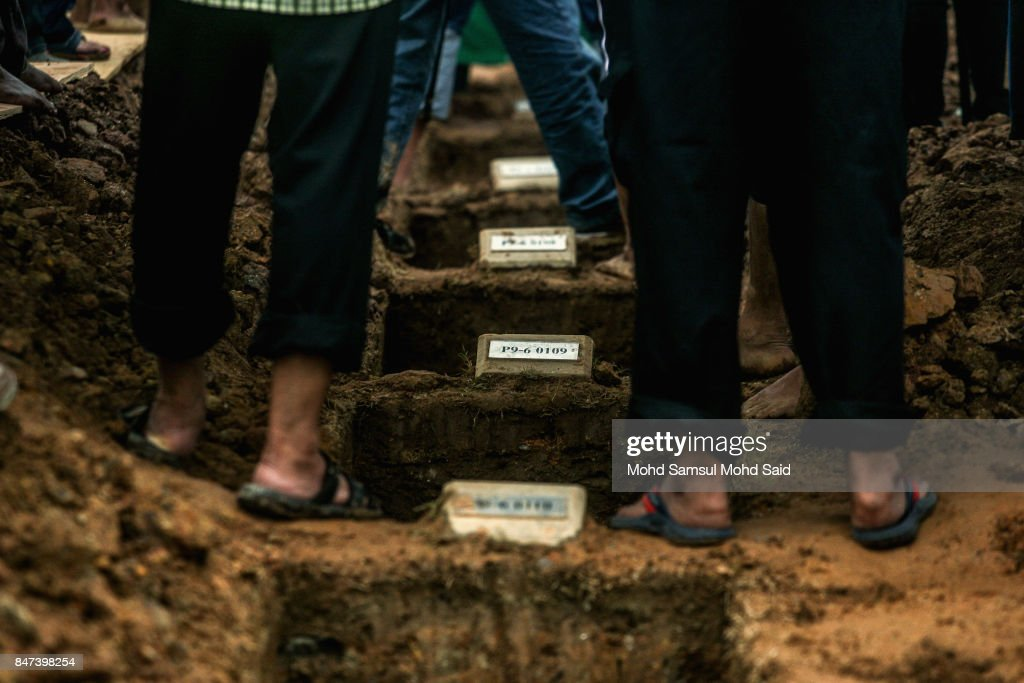 Eleven mass graves are seen during a burial ceremony at the Raudhatul Sakinah cemetery for victims of the religious school Darul Quran Ittifaqiyah after a fire broke out yesterday on September 15, 2017 in Kuala Lumpur, Malaysia. A fire at the religious school in the Malaysian capital killed almost two dozen people including 21 students and two teachers.