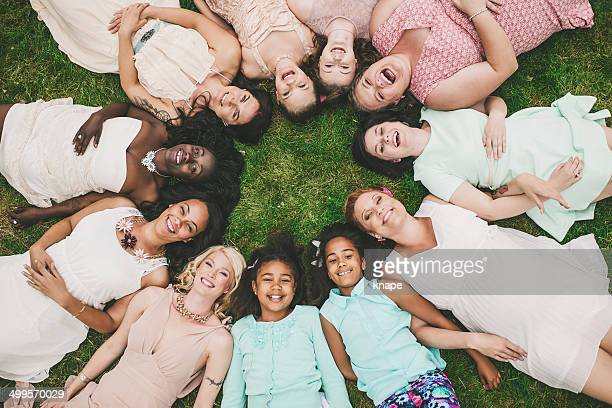 Eleven women in a cirle group of mothers and daughter