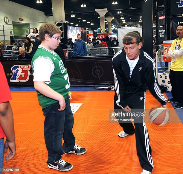 Eleven year old Drew Jacobs of Jackson New Jersey gets some ball handling tips from WNBA Player Kelly Miller at the NBA Jam Session sponsored by...