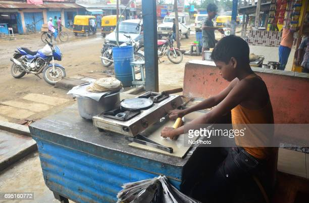Eleven yearold Indian boy Raju baked Roti at a roadside hotel on World Day Against Child Labour in Dimapur India northeastern state of Nagaland on...