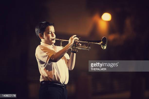 eleven years old kid playing the trumpet