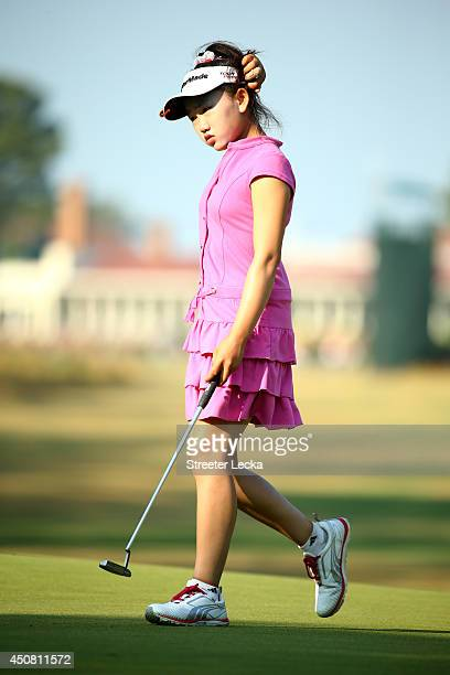 Elevenyear old Amateur Lucy Li of the United States walks the first green during a practice round prior to the start of the 69th US Women's Open at...