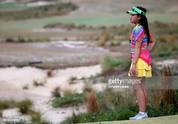 Elevenyear old Amateur Lucy Li of the United States watches the final group of Lexi Thompson and Michelle Wie during the third round of the 69th US...