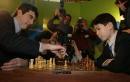 Elevenyearold British chess prodigy David Howell ponders his next chess move against World Chess Champion Vladinir Kramnik March 1 2002 at a speed...