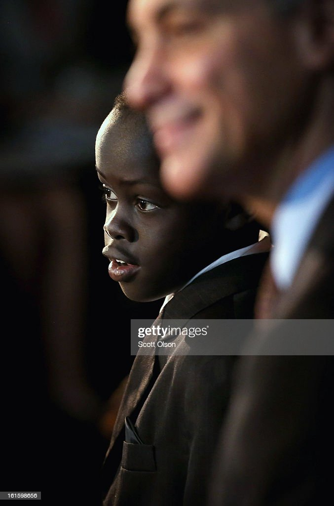 Eleven-year-old Mach Ayuen, from South Sudan, stands next to Mayor Rahm Emanuel after he received a citizenship certificate during a ceremony at the Chicago Cultural Center on February 12, 2013 in Chicago, Illinois. The ceremony was held to recognize as new U.S. citizens 62 children, ages 6-18, from 23 countries who were adopted from abroad or who derived U.S. citizenship when their immigrant parents were naturalized.