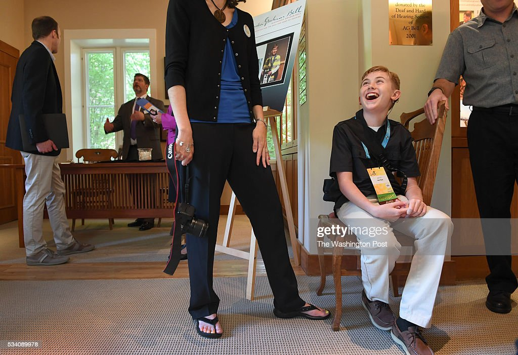 Eleven-year-old Neil Maes, who is deaf contestant in the Scripps National Spelling Bee, jokes with parents and teachers prior to a press conference at A. G. Bell in Washington, DC on May 24, 2016. Neil has bilateral cochlear implants and today talks about the challenges of using this technology and other assistive devices in their journey to this national competition.