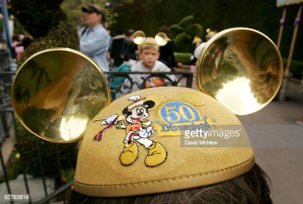 Elevenyearold Shawn Leu of Portland Oregon wears golden 50th anniversary commemorative mouse ears on his head during his 53rd trip to Disneyland on...