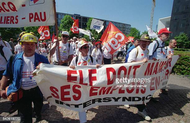 Elf Aquitaine workers stage a demonstration outside the oil company's headquarters in La Defense The workers from the office in Pau France came to La...