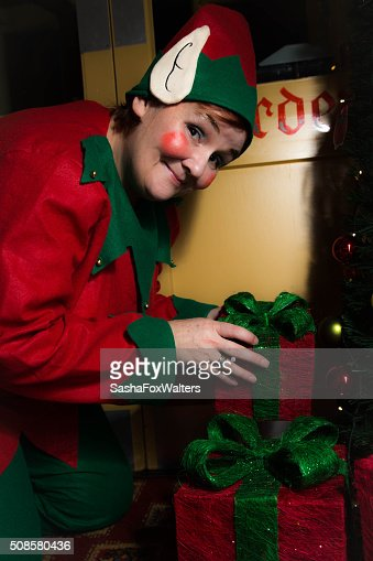 Elf delivering presents at christmas : Stock Photo