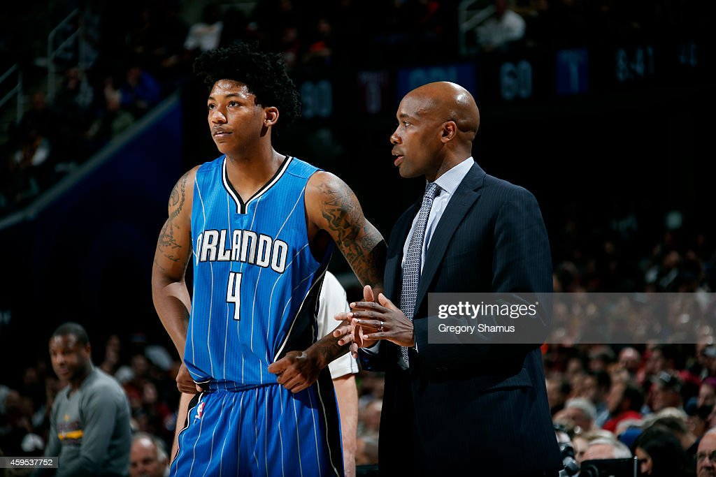 <a gi-track='captionPersonalityLinkClicked' href=/galleries/search?phrase=Elfrid+Payton&family=editorial&specificpeople=10012853 ng-click='$event.stopPropagation()'>Elfrid Payton</a> #4 and Head Coach <a gi-track='captionPersonalityLinkClicked' href=/galleries/search?phrase=Jacque+Vaughn&family=editorial&specificpeople=201747 ng-click='$event.stopPropagation()'>Jacque Vaughn</a> of the Orlando Magic speak during a game against the Cleveland Cavaliers at The Quicken Loans Arena on November 24, 2014 in Cleveland, Ohio.