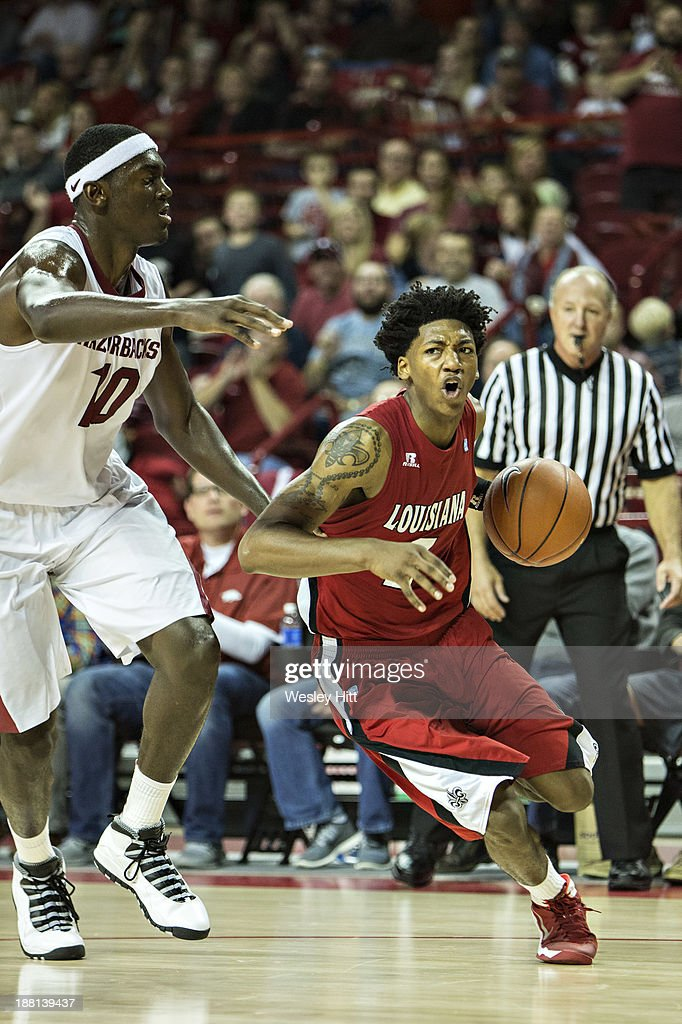 Elfrid Payton #2 of the Louisiana Ragin' Cajuns drives to the basket past Bobby Portis #10 of the Arkansas Razorbacks at Bud Walton Arena on November 15, 2013 in Fayetteville, Arkansas. The Razorbacks defeated the Ragin' Cajuns 76-63.